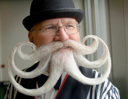 what does a handlebar mustache look like
